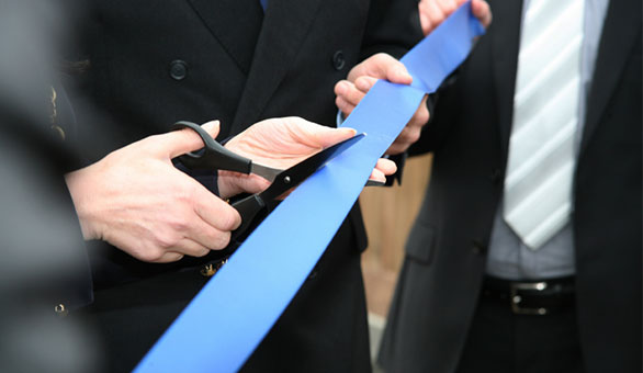 Person Cutting a Ribbon
