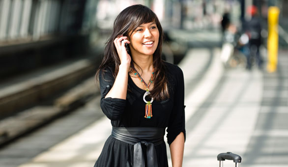 Entrepreneur Lady Traveling with a Phone