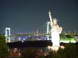 Statue of Liberty lit up at night
