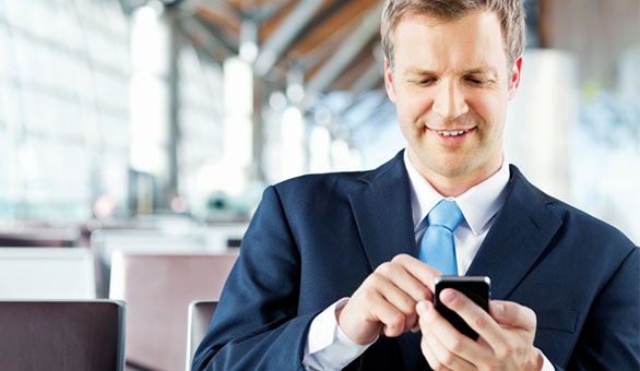 Entrepreneur Using a Mobile Phone at an Airport
