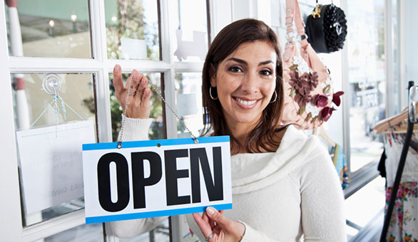 Business Women with an Open Sign